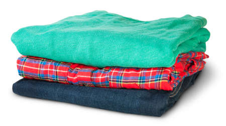 Stack Of Multicolored Casual Clothes Rotated Isolated On White Background photo