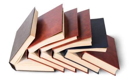 imbedded: Six old books imbedded in one another top view isolated on white background Stock Photo