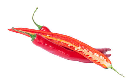 deployed: Two whole and one half red chili peppers deployed isolated on white background Stock Photo