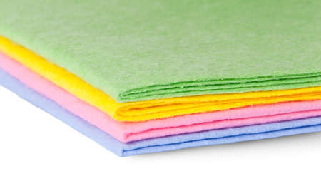 thorough: Closeup multicolored cleaning cloths isolated on white background Stock Photo
