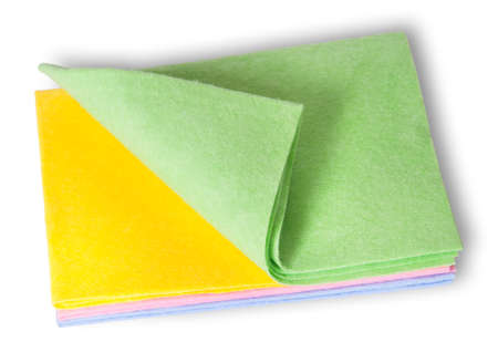 sort out: Multicolored cleaning cloths folded on top isolated on white background Stock Photo