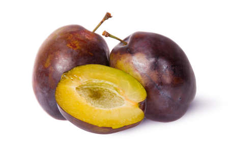 two and a half: Two violet plums and half isolated on white background Stock Photo