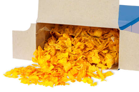 cereal box: Corn flakes spill out of cardboard box isolated on white background Stock Photo