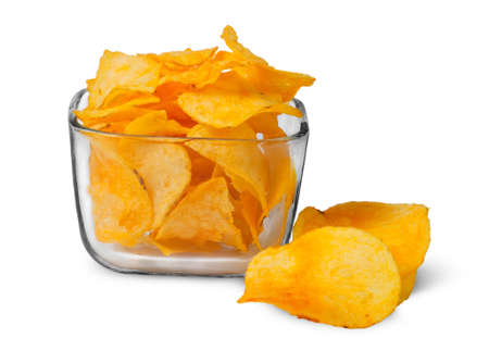 nosh: Potato chips in a glass bowl isolated on white background