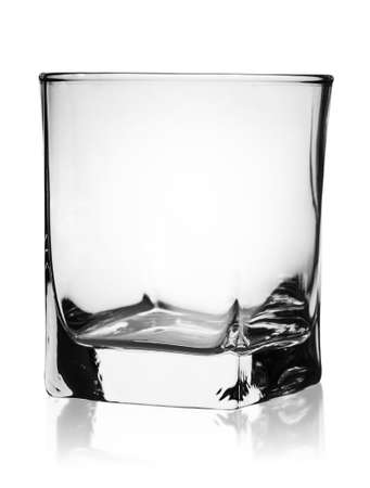 rotated: Empty glass for whiskey rotated isolated on white background