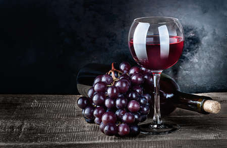 Wine with grapes and bottle