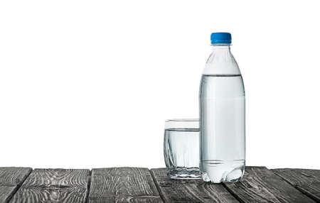 Plastic bottle and a glass with water 写真素材