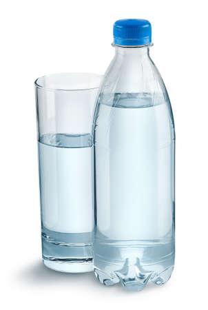Glass with water and a plastic bottle