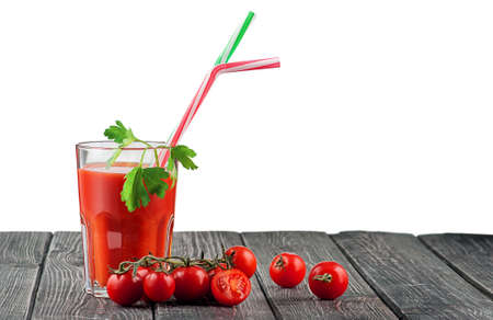 Glass of tomato juice with cocktail stick 写真素材