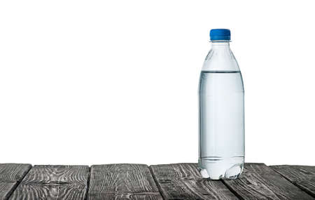 Plastic bottle of water on the table 写真素材