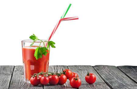 Cherry tomatoes with glass of tomato juice 写真素材