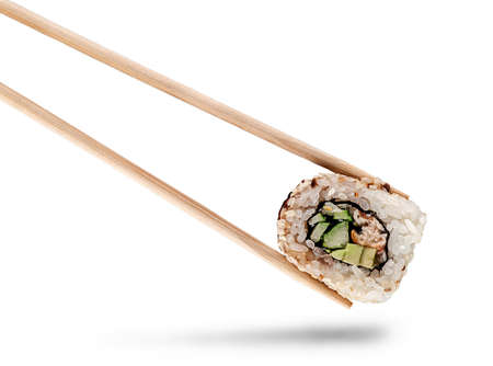 Sushi roll of california with chopsticks 写真素材