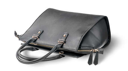 Ladies black leather bag lying