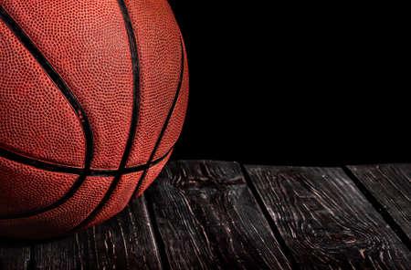 Closeup old ball on a wooden floor Reklamní fotografie
