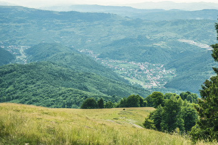 Slavic Romanian Est European landscape village between mountains Stock Photo