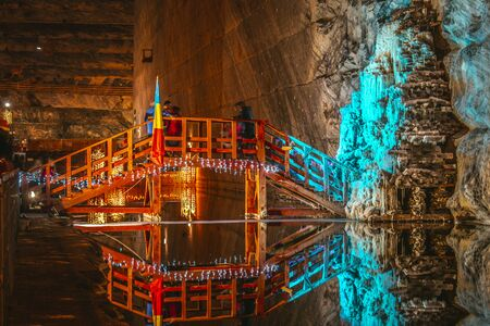 Salt Mine interior with colorful lights tourist attraction salt mine travel concept destination underground lake