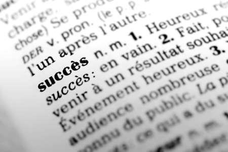 french text: Formula succes highlighted in dictionary with selective focus and blurred background  Stock Photo