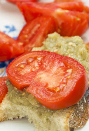 Eggplant salad with tomato and shallow depth of field photo