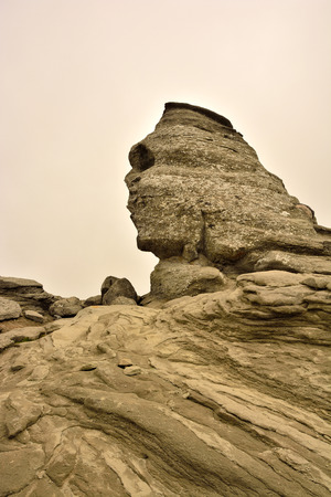 The rock formations of the Carpathian Mountains that resembles a human face , called Sphinx photo