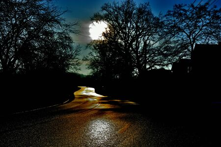 incertitude: Winding road in the night uncertainty