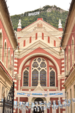 view synagogue in Brasov,Romania, city logo in the background