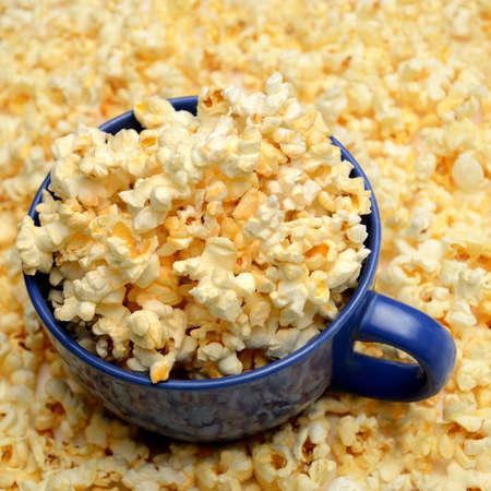 overflowing popcorn bowl Stock Photo