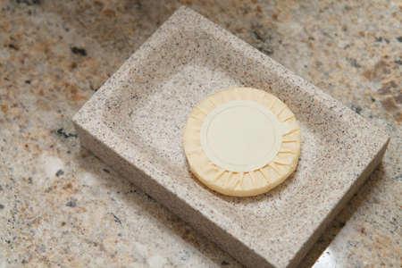 granite countertop: gift soap on granite countertop at hotel bathroom Stock Photo