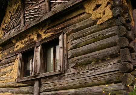 abandoned house window: old house made of wood in last century somewhere in romania