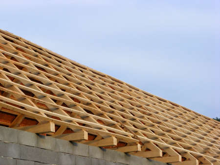 old house construction roof with tiles and wooden planks in the country photo