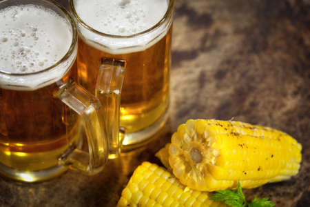 beers: Cold beers with corn on the cob Stock Photo