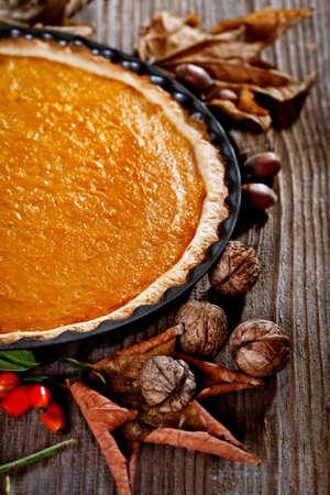 pumpkin pie: Thanksgiving pumpkin pie on a rustic table