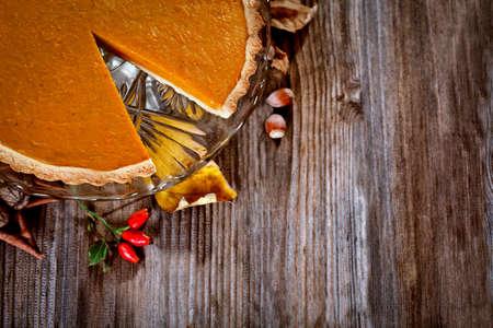 pumpkin pie: Thanksgiving pumpkin pie on a wooden background Stock Photo