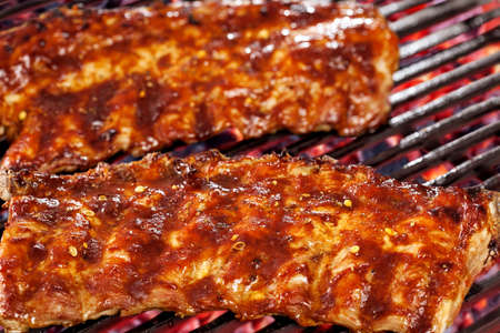 pork ribs: Marinated Pork Ribs on Barbecue Grill Stock Photo