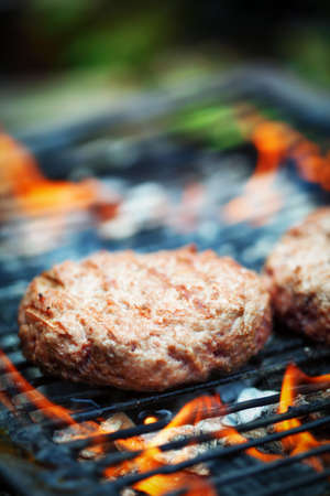 selective focus: Hamburgers on outdoor Grill