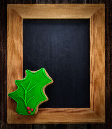 christmas holly: Christmas holly on wooden frame