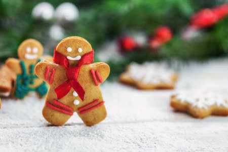 gingerbread cookies: Christmas gingerbread  men cookies on white wooden board with copy space