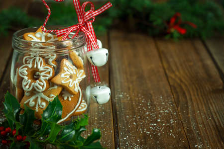 gingerbread cookie: Christmas Cookies in a jar on wooden background Stock Photo