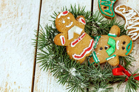 gingerbread cookies: Christmas gingerbread cookies on white wooden background