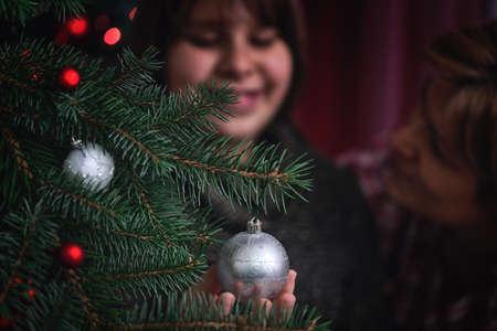 decorating christmas tree: Young girl decorating Christmas tree Stock Photo