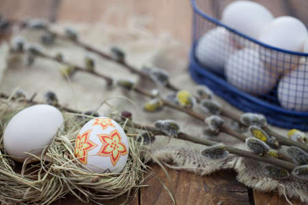 decoupage: Decoupage Easter eggs in nest on rustic wooden background Stock Photo