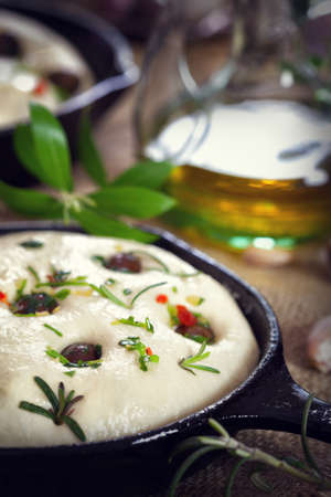 vertica: Italian Focaccia bread with olives and rosemary