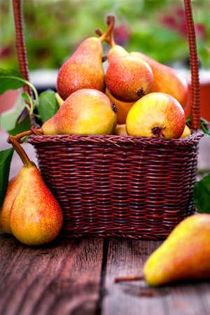 wicker basket: Ripe Pears in wicker basket