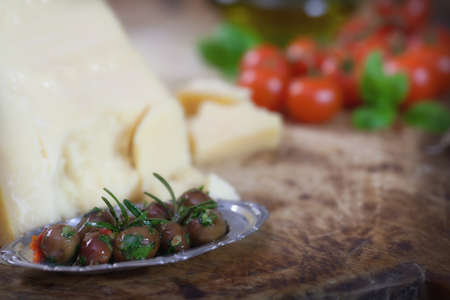 parmesan cheese: Black olives with Parmesan cheese and cherry tomatoes