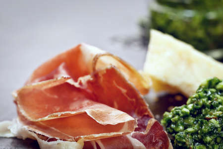 parma ham: Plate of Italian foods - parma ham and Parmesan cheese