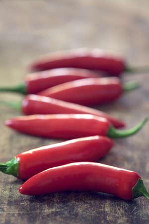 red jalapeno: Red jalapeno peppers on wooden table  with copy space Stock Photo