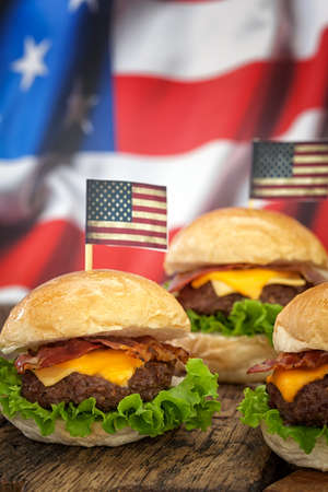 cheeseburgers: American Cheeseburgers with background flag Stock Photo