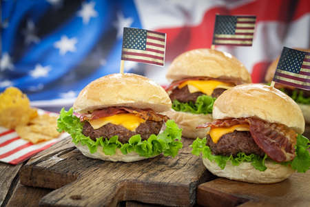 cheeseburgers: American 4th of July Cheeseburgers with background flag