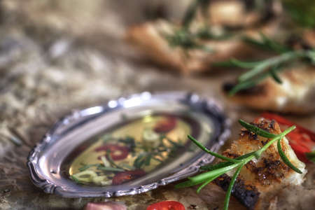 antipasto: Italian Antipasto - Appetizers with olive oil and herbs close up