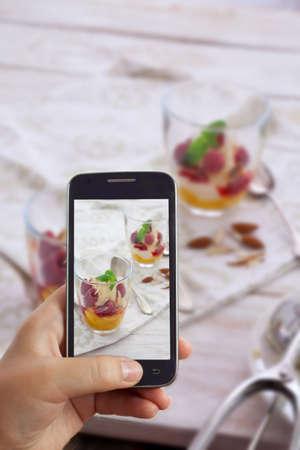melba: Taking Photo with Smartphone of Peach Melba ice cream dessert