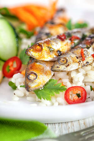 sardine: Grilled sardines with vegetables on rice close up
